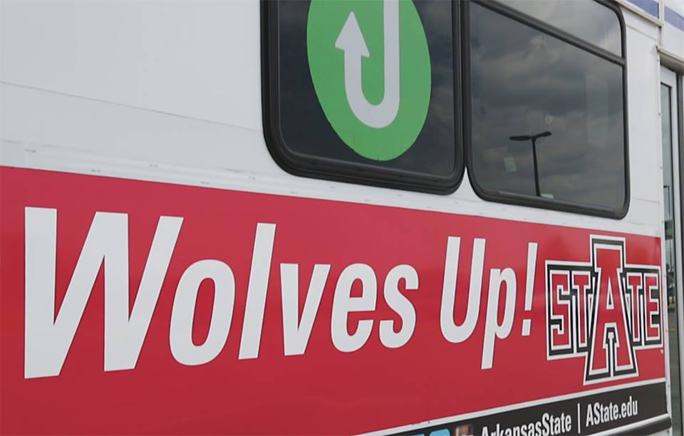 JET Bus with Wolves Up written on the side.
