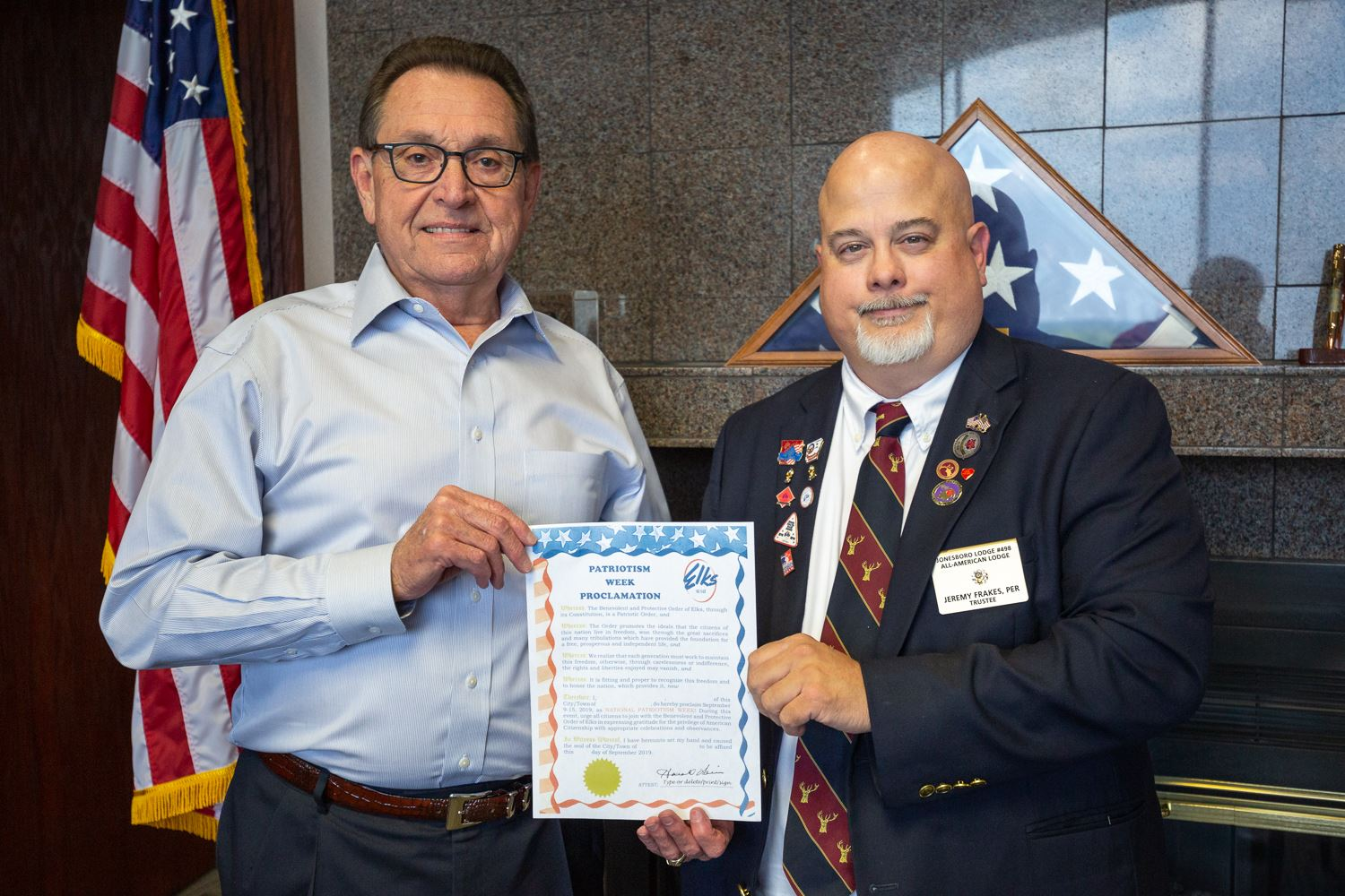 Mayor Perrin and American Chairman of Jonesboro Elks Lodge Jeremy Frakes, PER hold the Patriotism We