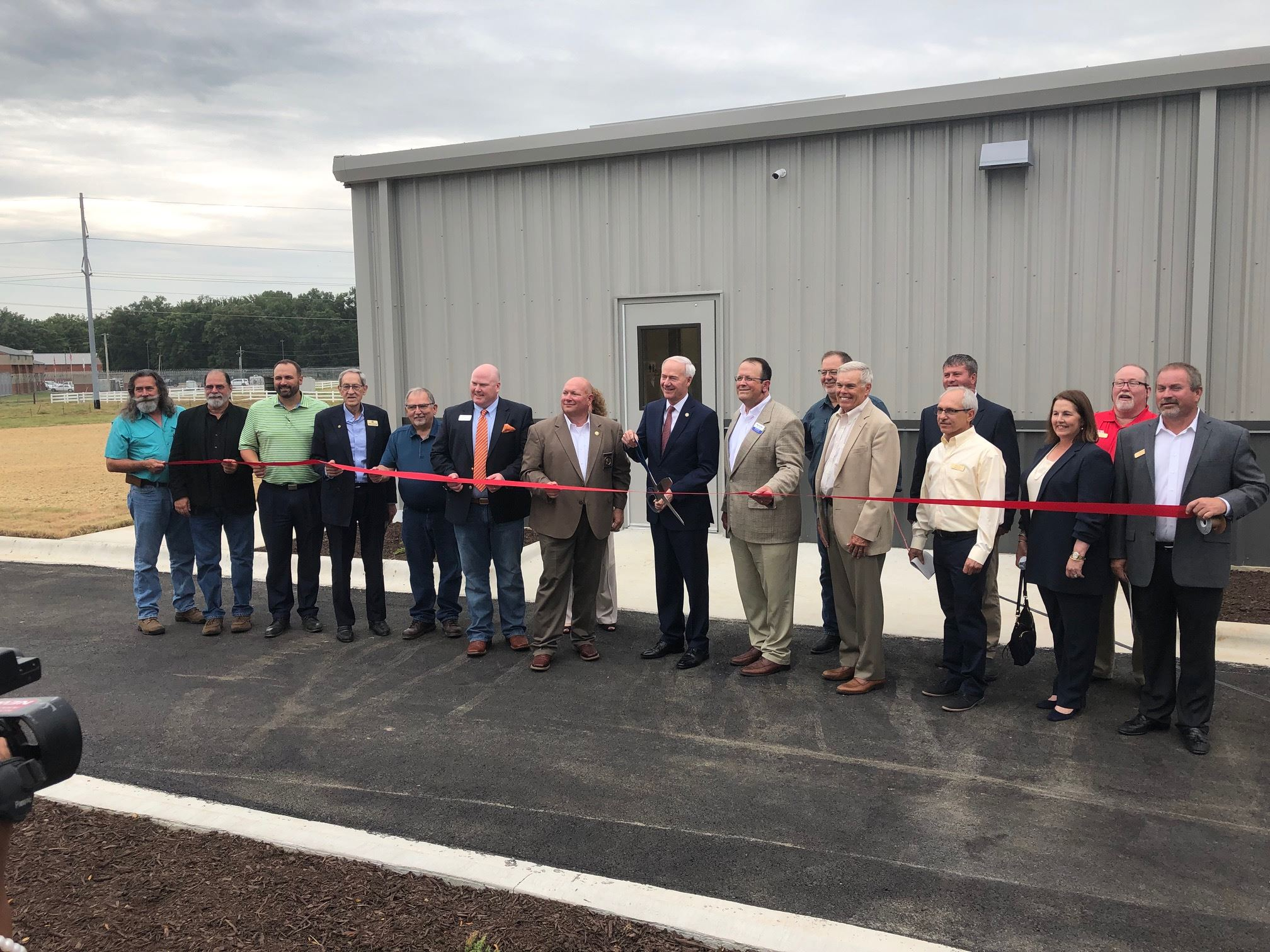 Governor Hutchinson with other officials including Mayor Perrin about to cut the ribbon for Craighea