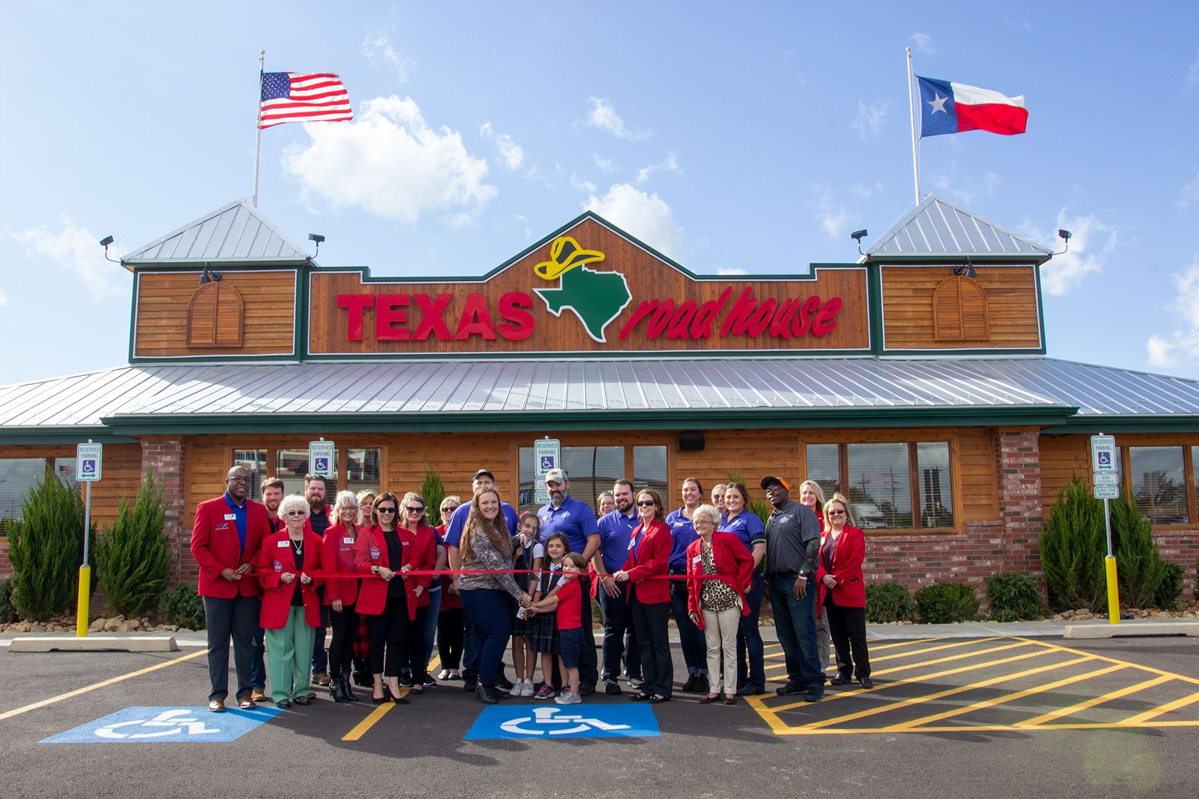 Texas Roadhouse ribbon cutting in front of restaurant