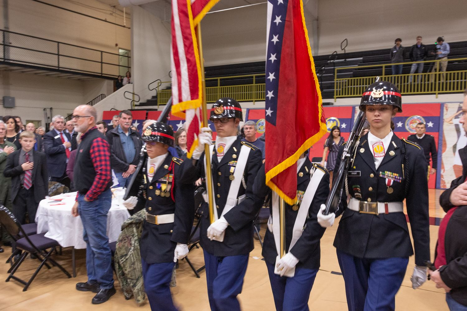 ROTC students march with the flag for presentation of the colors