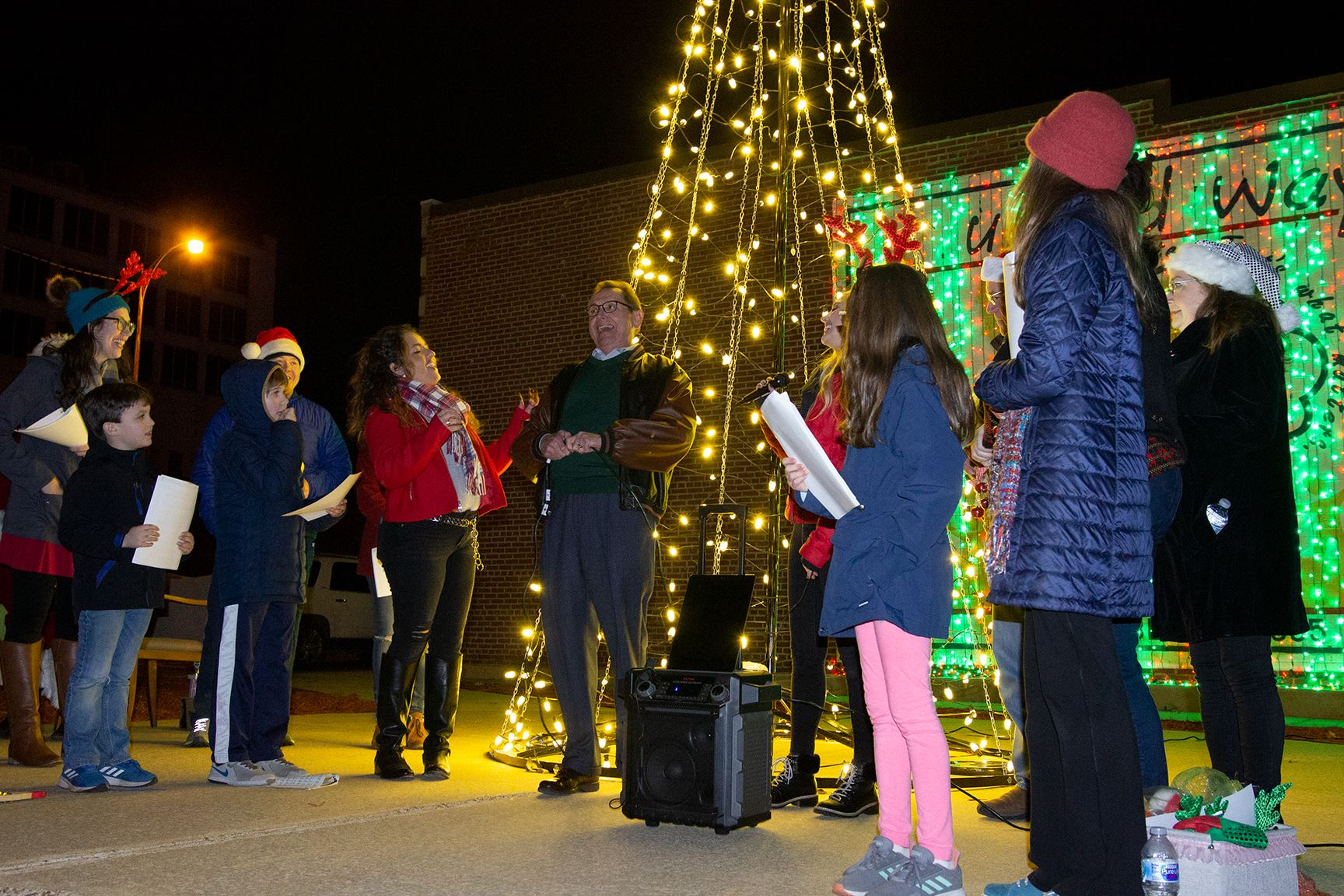 mayor lighting Christmas tree at Joyfest