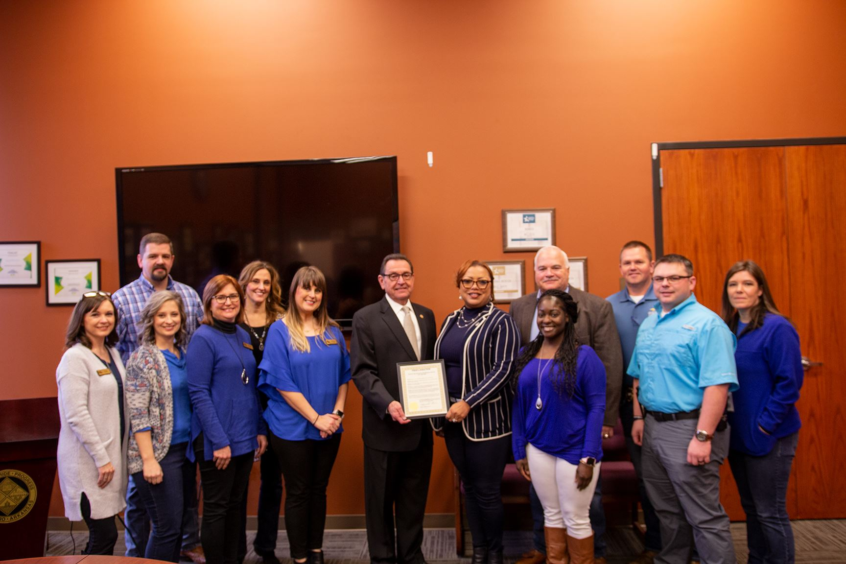 mayor with member of various organizations and proclamation for human trafficking awareness month