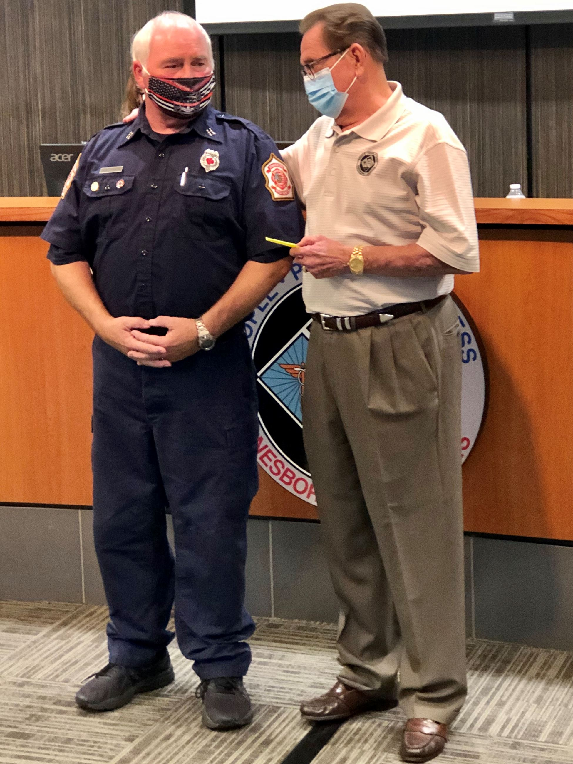 Mayor Perrin giving Captain Finley his 40-Year Service Pin